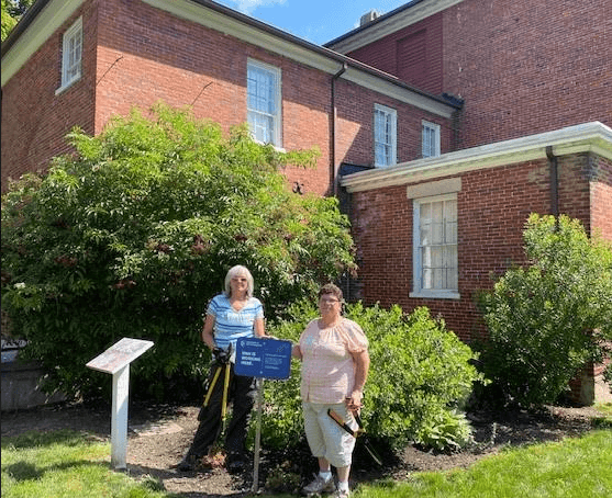 SCMG Interns l to R Nancy Volpe and Bernie Lincourt strategically pruning the Medicinal & Industrial Garden at the Woodman Museum